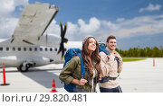 Купить «couple of tourists with backpacks over plane», фото № 29820481, снято 31 августа 2014 г. (c) Syda Productions / Фотобанк Лори