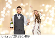Купить «man with bottle of champagne and glasses at party», фото № 29820489, снято 15 декабря 2017 г. (c) Syda Productions / Фотобанк Лори