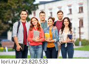 Купить «group of smiling students with books over campus», фото № 29820533, снято 10 ноября 2018 г. (c) Syda Productions / Фотобанк Лори