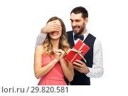 Купить «happy man giving woman surprise present», фото № 29820581, снято 30 ноября 2018 г. (c) Syda Productions / Фотобанк Лори