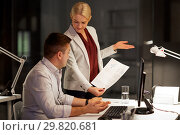 Купить «business team with papers working late at office», фото № 29820681, снято 6 декабря 2017 г. (c) Syda Productions / Фотобанк Лори