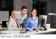 Купить «business team with computer working late at office», фото № 29820689, снято 6 декабря 2017 г. (c) Syda Productions / Фотобанк Лори