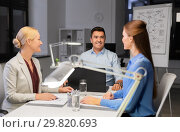 Купить «business team working at night office», фото № 29820693, снято 6 декабря 2017 г. (c) Syda Productions / Фотобанк Лори