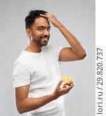 Купить «indian man applying hair wax or styling gel», фото № 29820737, снято 27 октября 2018 г. (c) Syda Productions / Фотобанк Лори