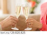 Купить «close up of couple clinking champagne glasses», фото № 29820825, снято 15 февраля 2018 г. (c) Syda Productions / Фотобанк Лори