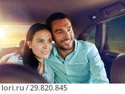 Купить «happy man and woman riding in a taxi back seat», фото № 29820845, снято 12 июня 2016 г. (c) Syda Productions / Фотобанк Лори