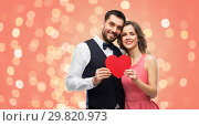 Купить «happy couple with red heart on valentines day», фото № 29820973, снято 30 ноября 2018 г. (c) Syda Productions / Фотобанк Лори
