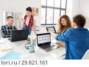 Купить «creative team working on user interface at office», фото № 29821161, снято 1 апреля 2018 г. (c) Syda Productions / Фотобанк Лори