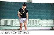 Купить «Training on the tennis court. Young man looking at the ball and then hitting it with a racket», видеоролик № 29821905, снято 20 ноября 2019 г. (c) Константин Шишкин / Фотобанк Лори