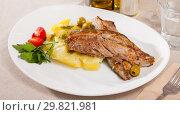 Купить «Delicious fried mackerel fillets with mashed potatoes, olives and tomatoes», фото № 29821981, снято 19 июля 2019 г. (c) Яков Филимонов / Фотобанк Лори
