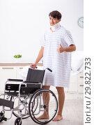 Купить «Young handsome man in wheelchair at the hospital», фото № 29822733, снято 6 сентября 2018 г. (c) Elnur / Фотобанк Лори