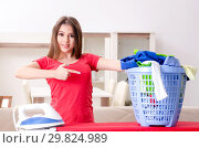 Купить «Young beautiful woman ironing at home», фото № 29824989, снято 30 октября 2018 г. (c) Elnur / Фотобанк Лори
