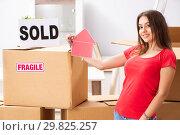 Купить «Young beautiful woman selling flat», фото № 29825257, снято 1 октября 2018 г. (c) Elnur / Фотобанк Лори