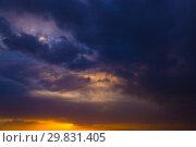 Dark stormy sky. Gloomy clouds. Overcast weather. Стоковое фото, фотограф Евгения Литовченко / Фотобанк Лори