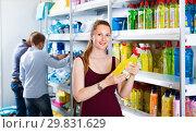 Купить «Girl displaying detergent at a household goods in the shop», фото № 29831629, снято 13 апреля 2017 г. (c) Яков Филимонов / Фотобанк Лори