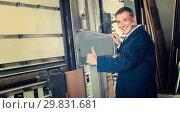 Купить «workman operating automatic machinery», фото № 29831681, снято 21 ноября 2019 г. (c) Яков Филимонов / Фотобанк Лори