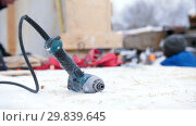Купить «Construction site. Hot glue gun on a foreground. A man controlling the building on the background», видеоролик № 29839645, снято 19 марта 2019 г. (c) Константин Шишкин / Фотобанк Лори