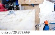 Купить «Construction site. Fastening the cargo. Drilling holes for fasteners», видеоролик № 29839669, снято 19 марта 2019 г. (c) Константин Шишкин / Фотобанк Лори