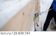 Купить «Construction site. Fastening the cargo. Hammering the cargo in the narrow space», видеоролик № 29839741, снято 29 января 2020 г. (c) Константин Шишкин / Фотобанк Лори