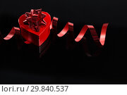 Купить «Valentine gift on black background», фото № 29840537, снято 11 октября 2018 г. (c) Wavebreak Media / Фотобанк Лори