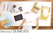 Купить «woman processing fragile parcels at post office», видеоролик № 29840973, снято 18 января 2019 г. (c) Syda Productions / Фотобанк Лори