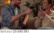 Купить «happy couple drinking red wine at home in evening», видеоролик № 29840981, снято 27 января 2019 г. (c) Syda Productions / Фотобанк Лори