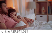 Купить «couple watching horror on tv in bed at night», видеоролик № 29841081, снято 27 января 2019 г. (c) Syda Productions / Фотобанк Лори