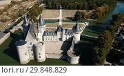 Купить «Aerial view of countryside of commune of Sully-sur-Loire with medieval fortified castle, France», видеоролик № 29848829, снято 24 октября 2018 г. (c) Яков Филимонов / Фотобанк Лори