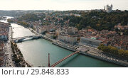 Купить «View from drone of Cathedral of Saint-Jean and Notre Dame Basilica on Fourviere hill on bank of river Saone in Lyon, France», видеоролик № 29848833, снято 24 октября 2018 г. (c) Яков Филимонов / Фотобанк Лори