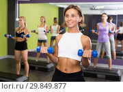 Купить «Females exercising aerobics with dumbbells at gym», фото № 29849877, снято 26 июля 2017 г. (c) Яков Филимонов / Фотобанк Лори