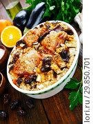 Купить «Chicken thigh baked with rice, eggplant and figs», фото № 29850701, снято 8 марта 2018 г. (c) Надежда Мишкова / Фотобанк Лори