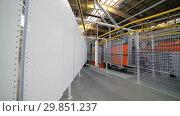 Купить «Powder coating line. Metal panels are suspended on an overhead conveyor line.», видеоролик № 29851237, снято 15 октября 2018 г. (c) Андрей Радченко / Фотобанк Лори