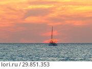 Купить «Yacht at sunset in the sea», фото № 29851353, снято 9 августа 2015 г. (c) Дмитрий Тищенко / Фотобанк Лори
