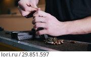 Shooting gallery. A young man charge the cartridge with a bullets. Стоковое видео, видеограф Константин Шишкин / Фотобанк Лори