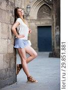 Купить «Young woman resting against old stone wall», фото № 29851881, снято 15 августа 2017 г. (c) Яков Филимонов / Фотобанк Лори