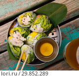 Купить «Ceviche rolls from white fish with rice paper in vietnamese style», фото № 29852289, снято 27 марта 2019 г. (c) Яков Филимонов / Фотобанк Лори