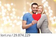 Купить «happy couple with red heart over festive lights», фото № 29874229, снято 9 февраля 2014 г. (c) Syda Productions / Фотобанк Лори