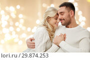Купить «happy couple hugging over lights on background», фото № 29874253, снято 8 октября 2015 г. (c) Syda Productions / Фотобанк Лори