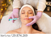 Купить «beautician doing beauty injection to woman lips», фото № 29874269, снято 26 января 2017 г. (c) Syda Productions / Фотобанк Лори