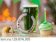 Купить «glass of beer, cupcake, horseshoe and gold coins», фото № 29874305, снято 31 января 2018 г. (c) Syda Productions / Фотобанк Лори