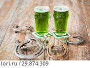 Купить «glasses of green beer with shamrock», фото № 29874309, снято 31 января 2018 г. (c) Syda Productions / Фотобанк Лори