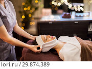 Купить «woman having face massage with towel at spa parlor», фото № 29874389, снято 26 января 2017 г. (c) Syda Productions / Фотобанк Лори