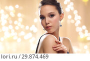 beautiful young asian woman wearing earrings. Стоковое фото, фотограф Syda Productions / Фотобанк Лори
