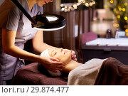 Купить «beautician doing face massage to woman at spa», фото № 29874477, снято 26 января 2017 г. (c) Syda Productions / Фотобанк Лори