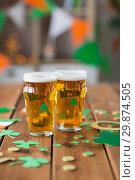 Купить «glasses of beer and st patricks day party props», фото № 29874505, снято 31 января 2018 г. (c) Syda Productions / Фотобанк Лори