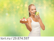 Купить «happy woman eating apple instead of cake», фото № 29874597, снято 23 марта 2013 г. (c) Syda Productions / Фотобанк Лори