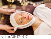 Купить «woman having face massage with towel at spa», фото № 29874617, снято 26 января 2017 г. (c) Syda Productions / Фотобанк Лори