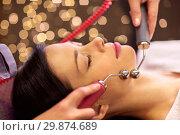 Купить «woman having hydradermie facial treatment in spa», фото № 29874689, снято 26 января 2017 г. (c) Syda Productions / Фотобанк Лори