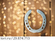 Купить «old horseshoe on wooden background», фото № 29874713, снято 31 января 2018 г. (c) Syda Productions / Фотобанк Лори