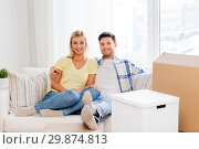 Купить «happy couple with boxes moving to new home», фото № 29874813, снято 25 февраля 2016 г. (c) Syda Productions / Фотобанк Лори